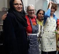MUSLIM LADIES COOK FOOD  FOR REFUGEE CENTRE
