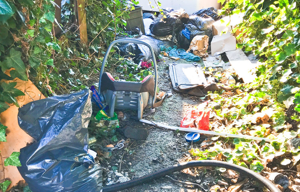 RESIDENTS CONDEMNED FOR USING FOOTPATH AS A DUMP