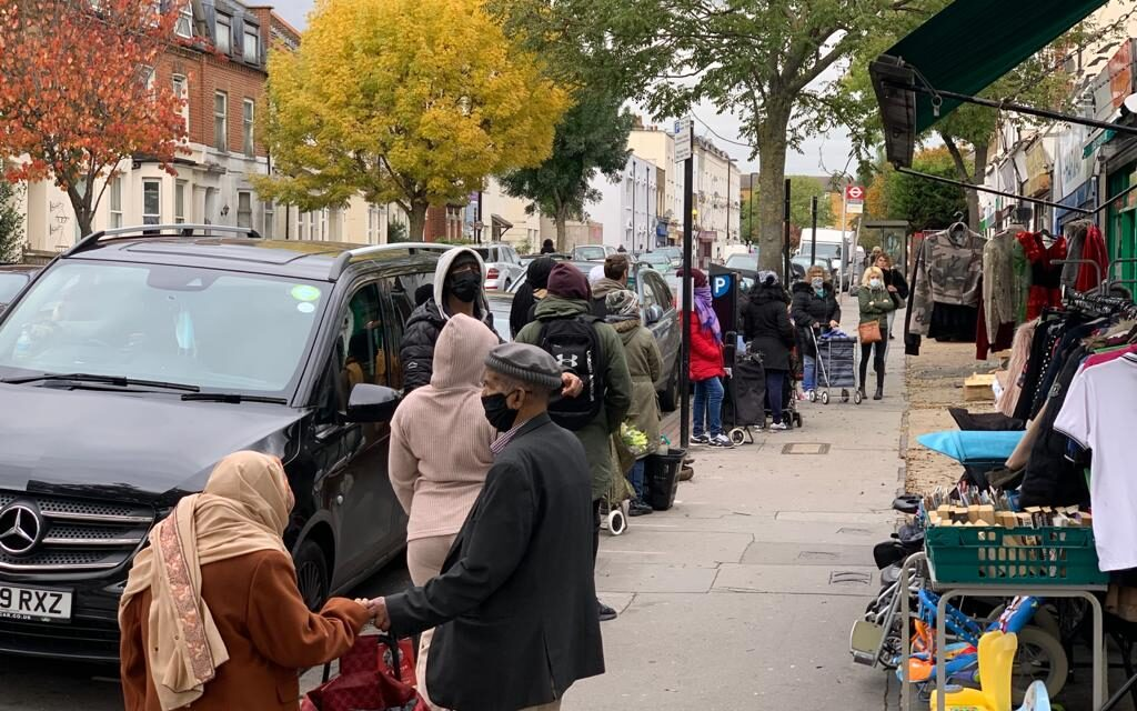 HUNDREDS OF PEOPLE FACING COVID POVERTY QUEUE FOR FOOD BANK